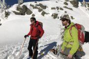John Baldwin and Ed McCarthy eye up the descent line. Mount Seymour Backcountry Skiing.